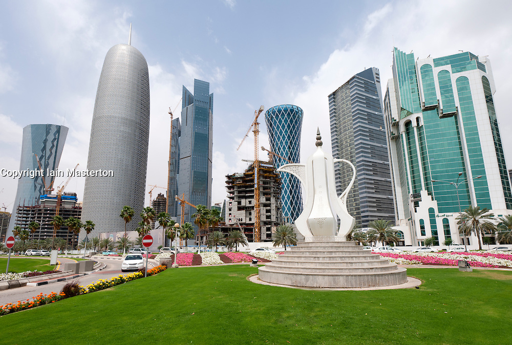 Tea pot monument and view of high rise office buildings in business district of Doha Qatar