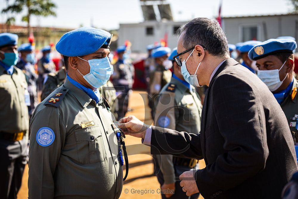 JUBA, SOUTH SUDAN- DECEMBER 23: Member of the Formed Police Unit 1 from Nepal serving with the United Nations Mission in South Sudan during a awarded UN medal ceremony in the UN House, Juba city, South Sudan, on 23 December 2020. Nepal is the world's fourth largest contributor of the uniformed personnel, currently with 5,700, to UN peacekeeping operations.<br /> Guang Cong (R), Deputy Special Representative of the UN Secretary-General. <br /> Photo by UN/Gregorio Cunha