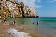People on the beach and swimmming at Praia do Beliche, Sagres, Algarve, Portugal