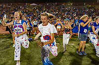 The Christian Brothers Falcons, student body runs onto the field after their 30-27 win over the Jesuit Marauders in the Holy Bowl at Hughes Stadium at Sacramento City College Saturday Sep 14, 2019.