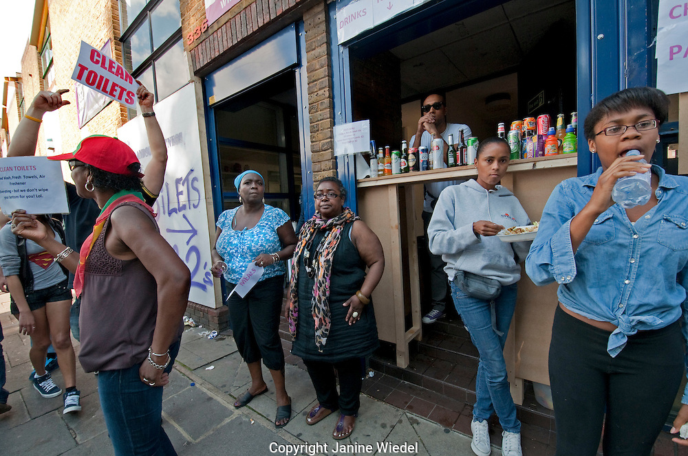 Hole in the wall shop at Notting Hill annual West Indian Carnival London  2011