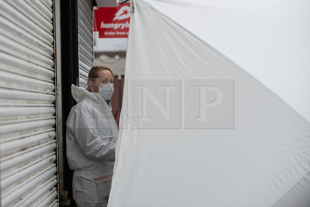 © Licensed to London News Pictures. 25/03/2016. <br /> <br /> Pictured: A Police Scotland Crime Scene Investigator at Delicious Deli, Clydebank. <br /> <br /> Police Scotland have focused the centre of the murder investigation of 15 year old Paige Doherty in Clydebank, Glasgow around the home and business premises of suspect John Leathem as they search his house and Delicious Deli near Fleming Street, Clydebank Glasgow on Friday 25th March 2016.<br /> <br />  Photo credit should read Max Bryan/LNP
