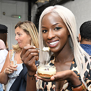 Sarah mulindwa is a presenter and stylist attend the Oppo party to launch its new Madagascan Vanilla, Sicilian Lemon and Raspberry Cheesecakes, served with Skinny Prosecco at Farm Girls Café, 1 Carnaby Street, Soho, London, UK on July 18 2018.