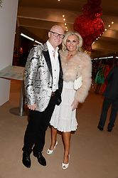 JOHN CAUDWELL and his wife CLAIRE CAUDWELL at the Masterpiece Midsummer Party in aid of Marie Curie Cancer Care held at The Royal Hospital Chelsea, London on 2nd July 2013.