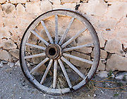 Stagecoach wheel of historic Butterfield Overland Mail. Hueco Tanks State Park & Historic Site is popular for birding and bouldering (rock climbing) in El Paso County, Texas, USA. History: Throughout the last 10,000 years, Hueco Tanks has provided water, food and shelter to travelers in the Chihuahuan Desert. People left clues to their stories in unique pictographs and petroglyphs visible today. Starting in 1858, Hueco Tanks served for a year as a relay station and water source for the historic Butterfield Overland Mail (which was then shifted south to a safer route). Twice a week, the Butterfield stagecoach carried passengers and US Mail in just 22 days to San Francisco starting from Memphis, Tennessee or St. Louis, Missouri; for the first time, people separated by nearly 2000 miles of wilderness could communicate. Escontrias Ranch started here in 1898, became a tourist attraction by the 1940s and became a country park in 1965, then a state park in 1969. Directions: From El Paso's Montana Avenue (US Highway 62/180), turn north at RM 2775.