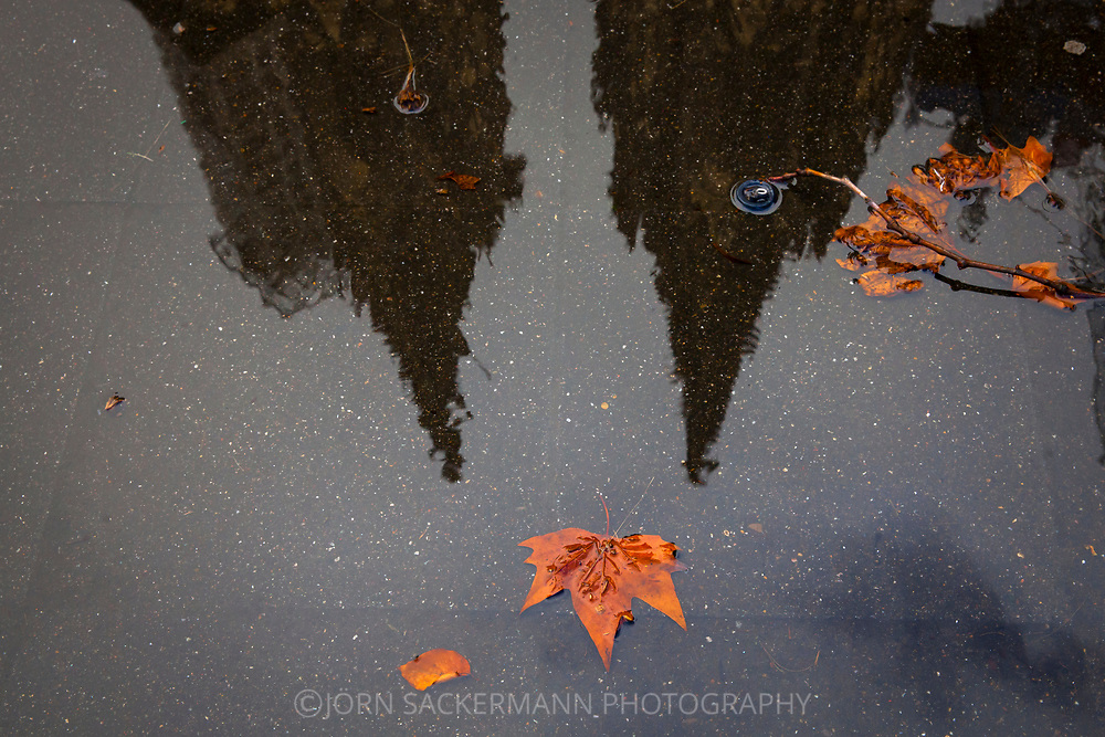 the steeples of the cathedral are reflected in a puddle, Cologne, Germany.<br /> <br /> die Tuerme des Doms spiegeln sich in einer Pfuetze, Koeln, Deutschland.