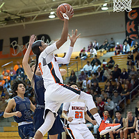 Quincy Smith (20) of Gallup goes up for a layup on the fast break against Piedra Vista High School on Tuesday night in Gallup.