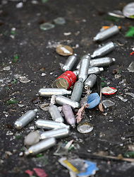 © Licensed to London News Pictures. 27/08/2019. London, UK. Empty canisters of nitrous oxide, AKA Hippy Crack left on the streets around Notting Hill, west London, in the aftermath of the 2019 Notting Hill carnival. The two day event is the second largest street festival in the world after the Rio Carnival in Brazil, attracting over 1 million people to the streets of West London. Photo credit: Ben Cawthra/LNP