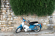 Moped parked under rosemary bush in Kioni, Ithaca, Greece. Ithaca, Ithaki or Ithaka is a Greek island located in the Ionian Sea to the west of continental Greece. Ithacas main island has an area of 96 square kilometres. It is the second-smallest of seven main Ionian Islands.