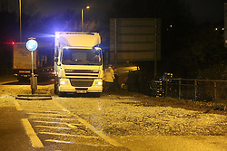 FE1KDW Southampton, Hampshire, UK. 4th February, 2016. A spillage of milk bottles led to the closure of a section of one of the major routes into Southampton city centre earlier.  Hampshire fire service said about 1,000 litres of milk came off the lorry on the A3024 at Bursledon.  The service said it had sent its Hazard Area Response Team to the scene to prevent the milk from getting into nearby water courses.  The road has since reopened between the Windhover Roundabout and the B3033.  The driver of the 44-tonne lorry is not believed to be injured. © uknip/Alamy Live News