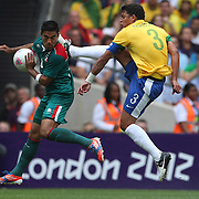 Marco Fabian, Mexico, is challenged by Thiago Silva, Brazil, (right) during the Brazil V Mexico Gold Medal Men's Football match at Wembley Stadium during the London 2012 Olympic games. London, UK. 11th August 2012. Photo Tim Clayton