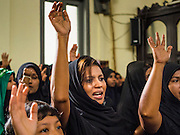 04 NOVEMBER 2014 - YANGON, MYANMAR:  Burmese Shia women pray in Mogul Mosque in Yangon during Ashura services. Ashura, commemorates the death of Hussein ibn Ali, the grandson of the Prophet Muhammed, in the 7th century. Hussein ibn Ali is considered by Shia Muslims to be the third imam and the rightful successor of Muhammed. He was killed at the Battle of Karbala in 610 CE on the 10th day of Muharram, the first month of the Islamic calendar. According to Myanmar government statistics, only about 4% of the population is Muslim. Many Muslims have fled Myanmar in recent years because of violence directed against Burmese Muslims by Buddhist nationalists.    PHOTO BY JACK KURTZ