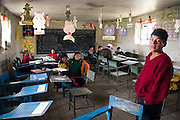 Students wait around while the teacher attends to younger children in the small elementary school in Q'eros, Cordillera de Paucartambo, Andes Mountains, Peru on September 15, 2005. The students are taught in both their native Quechua and Spanish, the official language of Peru. The Q'eros, a Quecha people living in the Peruvian Andes, are considered the last direct descendants of the Incas and proudly maintain many of the ancient traditions.
