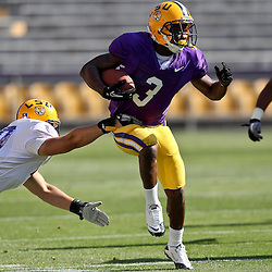 April 9, 2011; Baton Rouge, LA, USA;  LSU Tigers running back Jakhari Gore (3) runs through a tackle by safety Rockey Duplessis (40) during the 2011 Spring Game at Tiger Stadium.   Mandatory Credit: Derick E. Hingle
