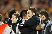 16th August, 2003. Eden Park, Auckland, New Zealand. Bledisloe Cup Match. New Zealand v Australia.<br />Mark Hammett hugs Keven Mealamu.<br />The All Blacks won the match, 21 - 17.<br />Pic: Andrew Cornaga/Photosport