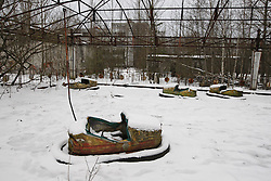 December 22, 2016 - Kiev, Ukraine - A view shows the amusement park in the deserted town of Pripyat,two kilometers from the Chernobyl nuclear power plant, Ukraine, on 22 December,2016. The explosion of Unit four of the Chernobyl nuclear power plant on 26 April 1986 is still regarded the biggest accident of nuclear power generation  in the history. (Credit Image: © Serg Glovny via ZUMA Wire)