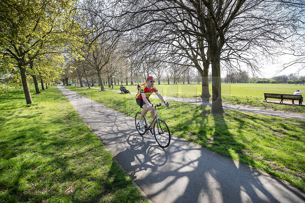 © Licensed to London News Pictures. 19/04/2018. London, UK. People enjoy the afternoon sunshine on Clapham Common - as parts of the UK are enjoying high unseasonal April temperatures. Photo credit: Peter Macdiarmid/LNP