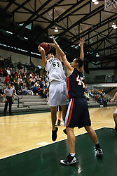 10 January 2009: Christina Solari takes a fading jump shot to get past Whitney Edgecombe. The Lady Titans of Illinois Wesleyan University downed the and Lady Thunder of Wheaton College by a score of 101 - 57 in the Shirk Center on the Illinois Wesleyan Campus in Bloomington Illinois.