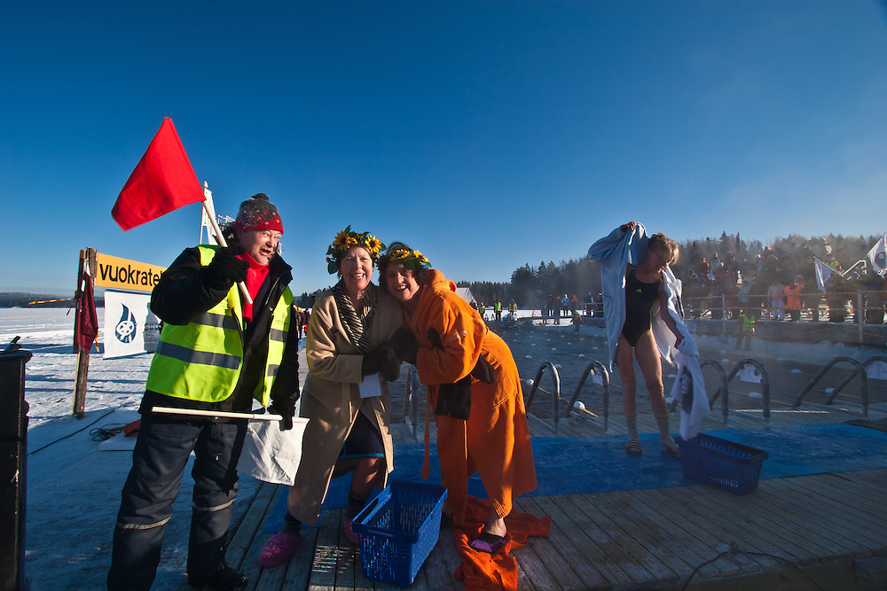 The competitors Marja-Liisi Ukkonen and Paula Kinnunen are having fun after their performance in Finnish Ice Swimming Championships in Ellivuori, Finland.