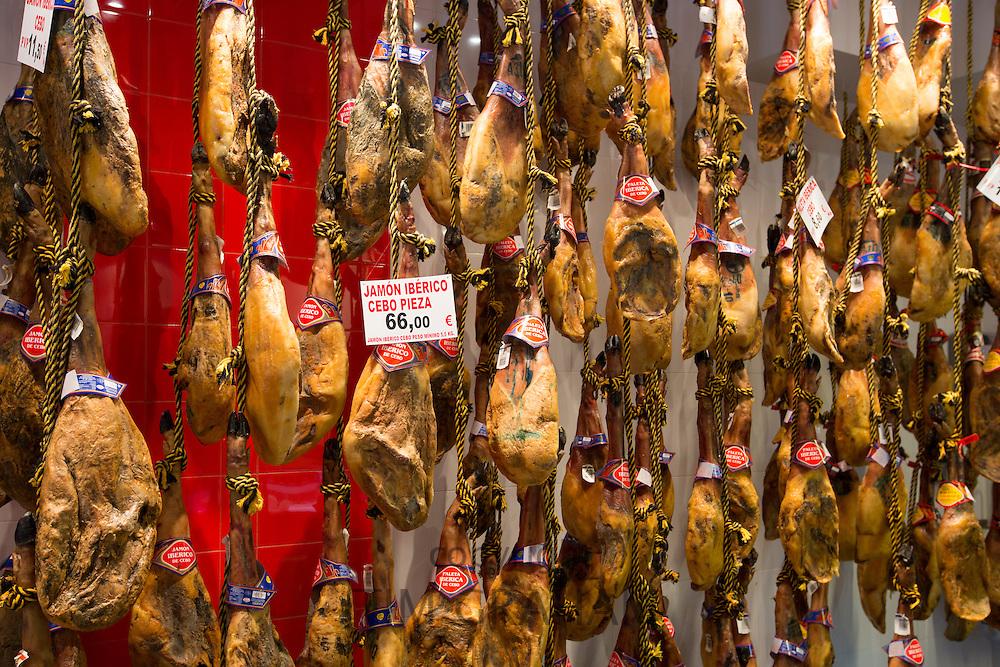Iberico Ham and other meats on sale in food shop in Calle de Bidebarrieta in Bilbao, Spain