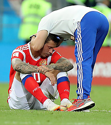 SOCHI, July 7, 2018  Fedor Smolov (L) of Russia sits on the pitch after the 2018 FIFA World Cup quarter-final match between Russia and Croatia in Sochi, Russia, July 7, 2018. Croatia won 6-5 (4-3 in penalty shootout) and advanced to the semi-finals. (Credit Image: © Yang Lei/Xinhua via ZUMA Wire)