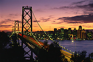 Sunset over the Oakland - San Francisco Bay Bridge and downtown San Francisco, California