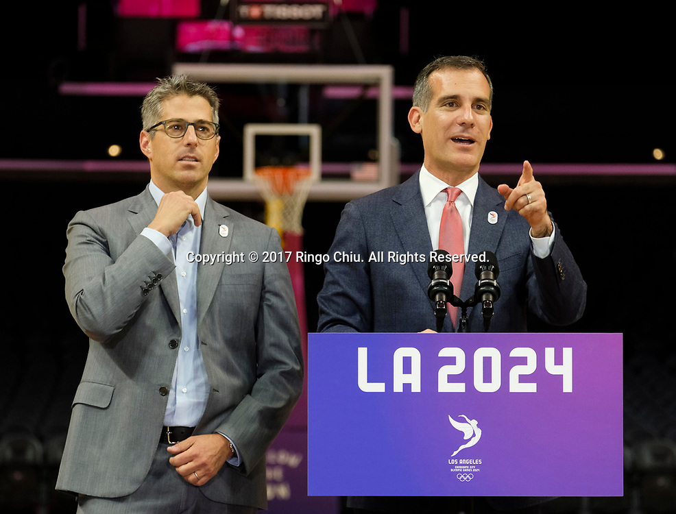 Los Angeles 2024 Chairman Casey Wasserman, left,and Los Angeles Mayor Eric Garcetti in a news conference at Staples Center, Friday, May 12, 2017, in Los Angeles. A team of International Olympic Committee delegates wrap up four days of evaluating Los Angeles' bid for the 2024 Games before heading to Paris to check the only other candidate.(Photo by Ringo Chiu/PHOTOFORMULA.com)<br /> <br /> Usage Notes: This content is intended for editorial use only. For other uses, additional clearances may be required.