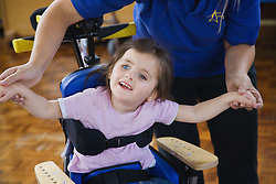 Girl with severe leaning disability exercising,