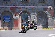 Motorcyclist on Honda motorbike drives The Stelvio Pass, Passo dello Stelvio, Stilfser Joch, to Bormio, Northern Italy