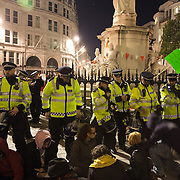 The square surrounded by police. The London Stock Exchange was attempted occypied in solidarity with Occupy Wall in Street in New York and in protest againts the economic climate, blamed by many on the banks. Police managed to keep people away fro the Patornoster Sqaure and the Stcok Exchange and thousands of protestors stayid in St. Paul's Square, outside St Paul's Cathedral. Many camped getting ready to spend the night in the square.