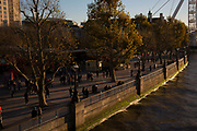 Autumn scene with sun setting on the Southbank riverside walkway, London, United Kingdom. The South Bank is a significant arts and entertainment district, and home to an endless list of activities for Londoners, visitors and tourists alike. (photo by Mike Kemp/In Pictures via Getty Images)
