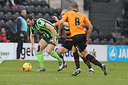 Jon Meades of AFC Wimbledon beats the weather and Barnets midfield during the Sky Bet League 2 match between Barnet and AFC Wimbledon at Underhill Stadium, London, England on 20 February 2016. Photo by Stuart Butcher.