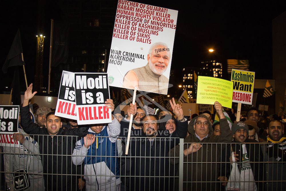 Amid high security measures, hundreds of Kashmiri protesters  outside Wembley Stadium after an address to more than 60,000 Indian expats by Prime Minister Narendra Modi at a 'UK Welcomes Modi' reception. Modi, a Hindu and his BJP party are accused of a wide range of human rights abuses against religious and ethnic minorities in India. PICTURED: Kashmiri protesters vent their fury as Modi supporters leave the stadium.