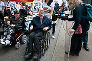 Westminster 11th May 2011. Hardest hit demonstration against government cuts to services to people with disabilities. Camerawoman with crutch filming the demonstration.
