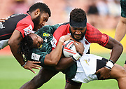 PNG's William Tirang tackled by Rosko Specman.<br /> NZ v France. HSBC World Rugby Sevens Series. FMG Stadium Waikato, Hamiton, New Zealand. Day 1, Saturday 3 February 2018. © Copyright photo: Andrew Cornaga / www.photosport.nz