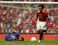 Photo: Richard Lane. Digitalsport<br /> Arsenal v Manchester United. FA Community Shield. 08/08/2004.<br /> Manchester United play on dispite Jeremie Alaidiere being seriously injured.