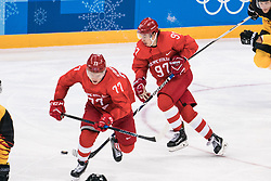 PYEONGCHANG, Feb. 25, 2018  Nikita Gusev (2nd R) of Olympic athletes from Russia drives the puck during men's ice hockey final against Germany at Gangneung Hockey Centre, in Gangneung, South Korea, Feb. 25, 2018. The Olympic Athletes from Russia team defeated Germany 4:3 and won the gold medal. (Credit Image: © Wu Zhuang/Xinhua via ZUMA Wire)