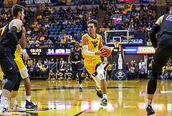 Mar 20, 2019; Morgantown, WV, USA; West Virginia Mountaineers forward Emmitt Matthews Jr. (11) drives down the lane during the second half against the Grand Canyon Antelopes at WVU Coliseum. Mandatory Credit: Ben Queen