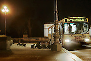 San Francisco, CA, USA - Their masked faces give a clue as to their devious ambitions - but this is no stick-up.  This group of critters regularly queue up for the No.18 bus in San Francisco to get a bite to eat.  The bus stop raccoons have become regular visitors, thanks to the driver's habit of dispensing treats as he stops off outside the city's Legion of Honour museum. The image was posted by a blogger and has become an internet hit.  Although many posters have described the ritual as 'cute', there are fears that once the authorities find out, the animals will be rounded up.  The furry creatures are known to be feisty, clever animals, regularly breaking into people's houses in search of food.  But experts warn they carry rabies and an 'intestinal parasitic worm that will cause severe disease if it infects humans.' Last month a pack of raccoons mauled a 74-year-old Florida woman after she tried to chase them from her back yard.  The pensioner was taken to hospital with extensive cuts from her neck to her legs.  Sheriff Grady Judd, of Polk County, east of Tampa, said: 'We're not talking about a lot of little bites here. She was filleted.' Photo Shows; Standing to attention: Although a heart-warming sight, raccoons are known to be feisty creatures and can carry rabies<br /> ©Exclusivepix
