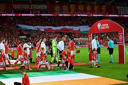 CARDIFF, WALES - Monday, October 9, 2017: Wales' captain Ashley Williams leads his team out before the 2018 FIFA World Cup Qualifying Group D match between Wales and Republic of Ireland at the Cardiff City Stadium. (Pic by Paul Greenwood/Propaganda)
