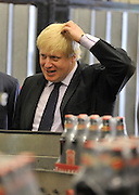 © licensed to London News Pictures. LONDON, UK.  02/06/11. Boris Johnson at the London Pride bottling plant at Fuller's Brewery today. The Mayor of London Boris Johnson visits two major manufacturing firms today, 02 June 2011, to see the role they play in supporting London's economy and why the UK's capital city  is so critical to their continued success. He called in to Fuller's in Chiswick, London's only traditional family brewery, to see their new multi-million pound brewing facility. He went on to visit Brompton bike factory. Where he met Brompton inventor Andrew Ritchie, who still owns the famous company and remains its Technical Director.  Photo credit should read Stephen Simpson/LNP