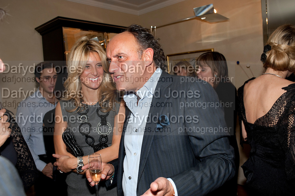 ANNA SCOLARO; ; FRANK SCOLARO;  Dinner hosted by Denise Estfandi, for the Council of the Serpentine Gallery to celebrate the opening of  Nancy Spero at the Serpentine Gallery. London.  Upper Brook house. 10a upper brook st.1 March 2011. -DO NOT ARCHIVE-© Copyright Photograph by Dafydd Jones. 248 Clapham Rd. London SW9 0PZ. Tel 0207 820 0771. www.dafjones.com.