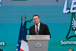 File photo - Tesla Motors CEO and chairman of SolarCity Elon Musk delivers his speech during the Climate Summit for Local Leaders held at the Paris city hall Hotel de Ville, as part of the COP21 UN Conference on Climate Change, in Paris, France on December 4, 2015. - Tech entrepreneur Elon Musk has revealed he has Asperger's syndrome while appearing on the US comedy sketch series Saturday Night Live (SNL). Photo by Jacques Witt/Pool/ABACAPRESS.COM