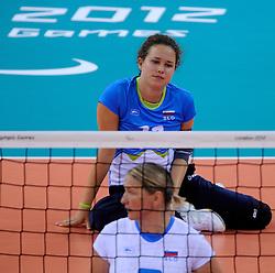 01-09-2012 ZITVOLLEYBAL: PARALYMPISCHE SPELEN 2012 USA - SLOVENIE: LONDEN.In ExCel South Arena wint USA van Slovenie / Lena GABRSCEK.©2012-FotoHoogendoorn.nl.