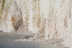 © Licensed to London News Pictures. 04/02/2018. Brighton, UK. Fallen rocks at the base of the cliffs at Birling Gap and Beachy Head where members of the public reputedly approach the cliff edge. .  Photo credit: Hugo Michiels/LNP