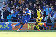 AFC Wimbledon midfielder Liam Trotter (14) clearing ball during the EFL Sky Bet League 1 match between AFC Wimbledon and Oxford United at the Cherry Red Records Stadium, Kingston, England on 29 September 2018.