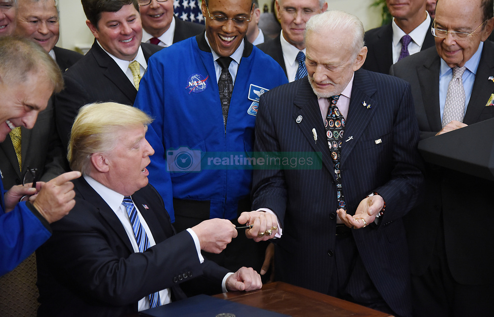 June 30, 2017 - Washington, District of Columbia, United States of America - United States President Donald J. Trump, gives the pen to Apollo 11 astronaut Buzz Aldrin (R) after signing an Executive Order to reestablish the National Space Council in the Roosevelt Room of the White House in Washington, DC, on June 30, 2017. .Credit: Olivier Douliery / Pool via CNP (Credit Image: © Olivier Douliery/CNP via ZUMA Wire)