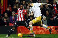 Florian Jozefzoon of Brentford (L) takes on Daniel Pudill of Sheffield Wednesday (R). EFL Skybet football league championship match, Brentford v Sheffield Wednesday at Griffin Park in London on Saturday 30th December 2017.<br /> pic by Steffan Bowen, Andrew Orchard sports photography.