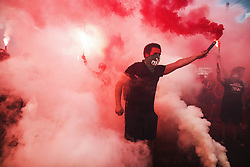 August 1, 2018 - Wroclaw, Poland - People light flares as they commemorate the 74th anniversary of the 1944 Warsaw Uprising at a street in the city center in Wroclaw. (Credit Image: © Krzysztof Zatycki/Pacific Press via ZUMA Wire)