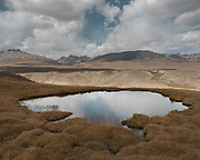 """High altitude Lake. From Aqbelis pass to Baiqara, a Wakhi high pasture. Guiding and photographing Paul Salopek while trekking with 2 donkeys across the """"Roof of the World"""", through the Afghan Pamir and Hindukush mountains, into Pakistan and the Karakoram mountains of the Greater Western Himalaya."""